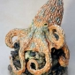 Moger-Jill-Octopus-on-rock-with-mussels---stoneware-ceramic---34x27cms---£1200.jpg