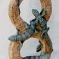 Moger-Jill-Five-Tokay-geckos-on-figure-eight-stonework.jpg
