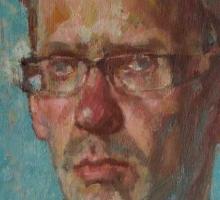 James-A-self-portrait-blue-background-med.jpg